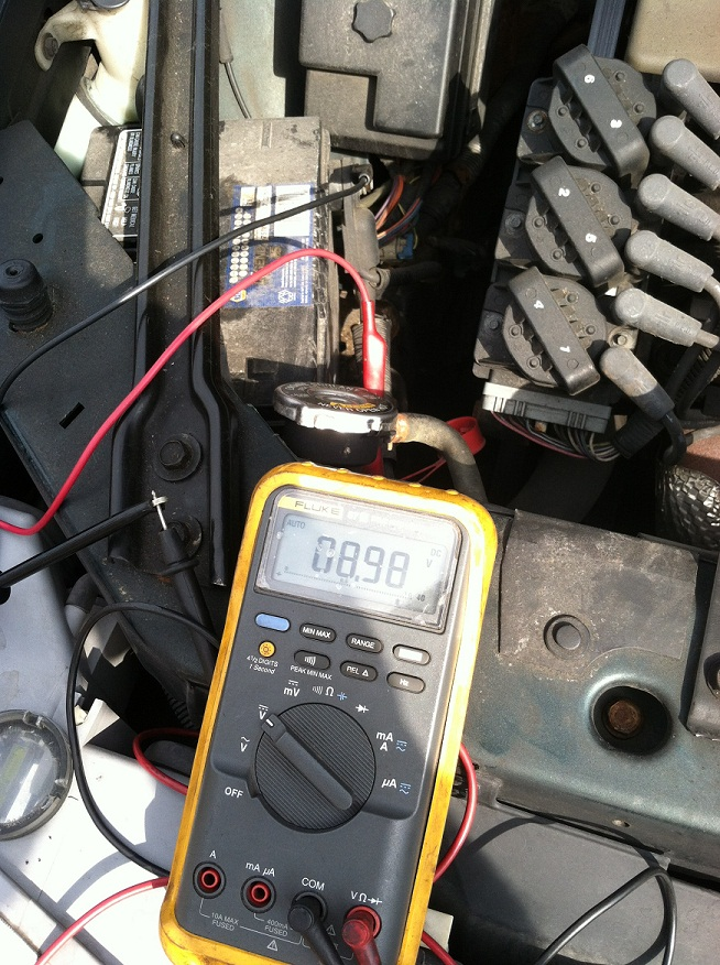 Taking a voltage reading from the battery